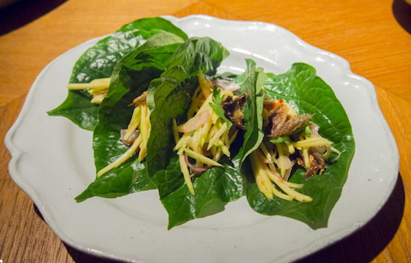 Salted thread fin perch on betel leaves.