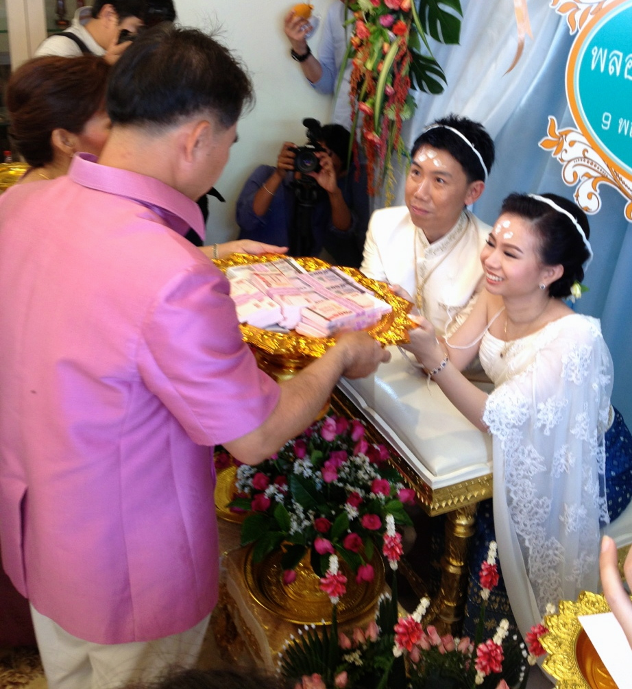 The bride's parents gave some money for the couple as a gift to start their family.