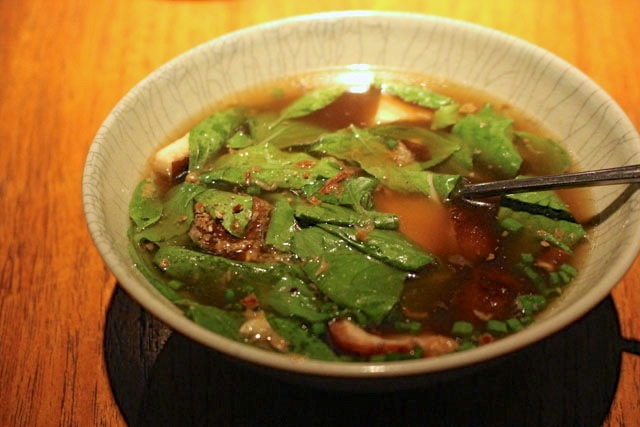 Clear soup of roast duck with Thai basil and young coconut.